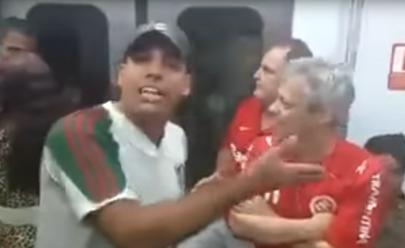 Em vídeo, torcedor do Fluminense humilha idoso torcedor do Inter em trem: 'cara de otário'; assista