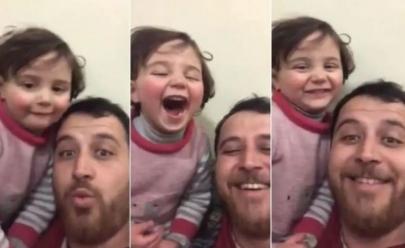 Pai torna bombardeio na Síria em uma festa de risos com a filha e viraliza na web; veja o vídeo